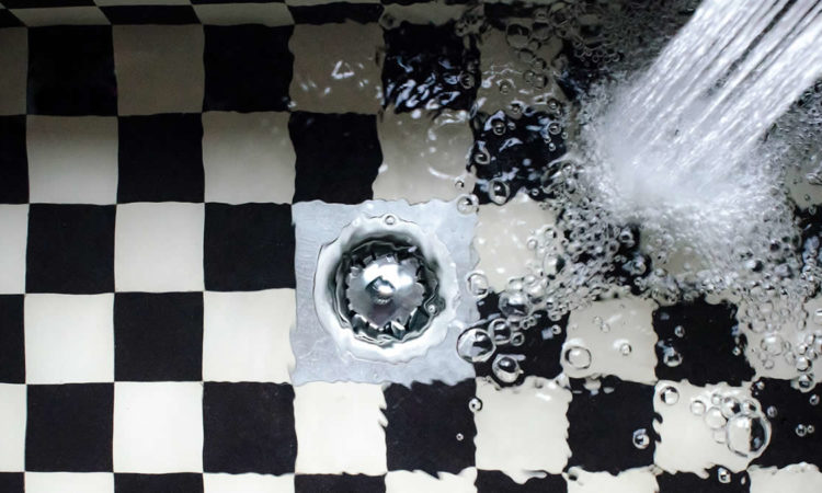 Water flowing in checkered bath tub